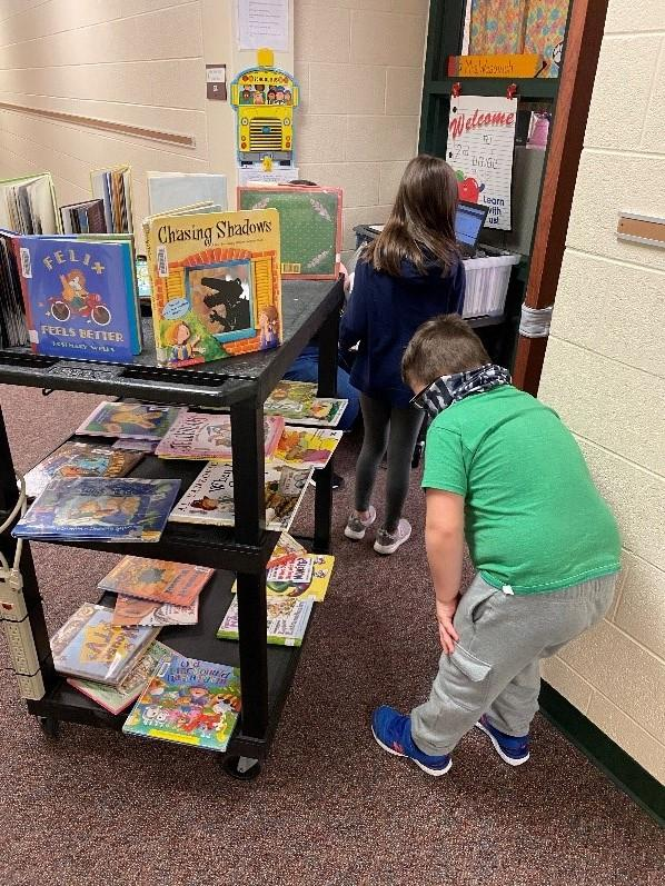 students checking out books