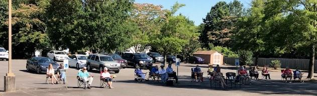 People in cars and in lawn chairs worshipping