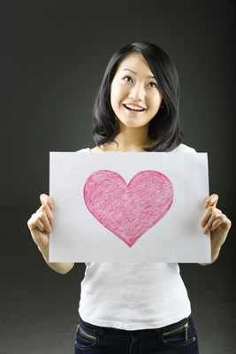 girl holding heart-drawing