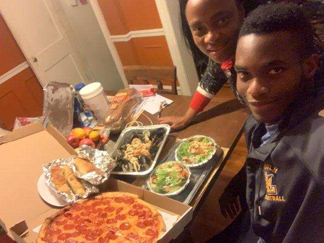 Hope Idowu and his mother, winner of our October Family Pizza Night