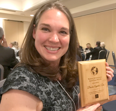Annie Accepts EBJ Award