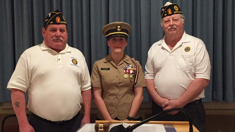 Cadet Weaber flanked by Post Commander Tim Barton and Post Adjutant Robert Johns following her award ceremony at Burt J. Aspers Post 46 of the American Legion.