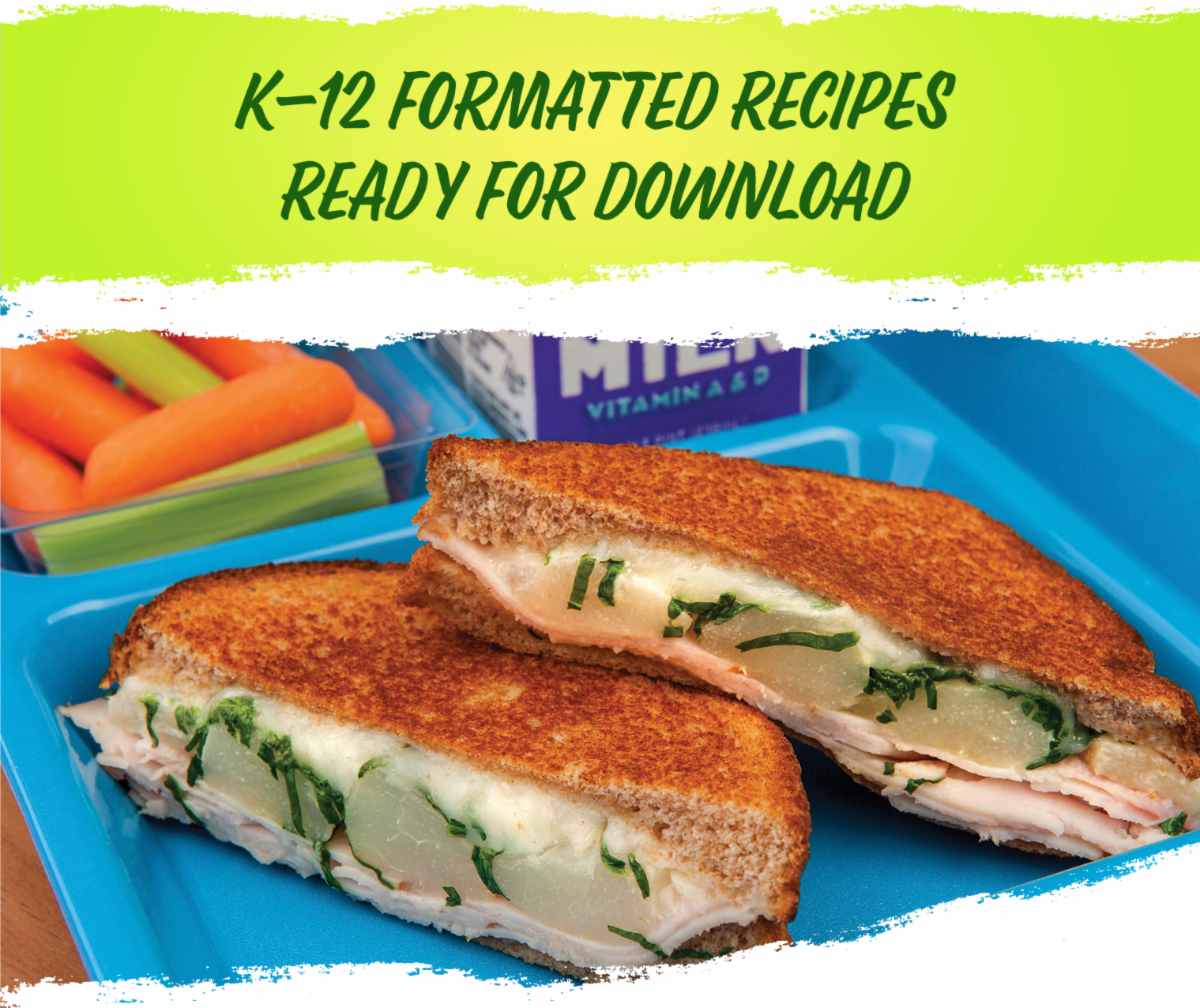 """Toasted grilled cheese with pears on a blue tray . Text, """"k-12 formatted recipes available for download"""""""