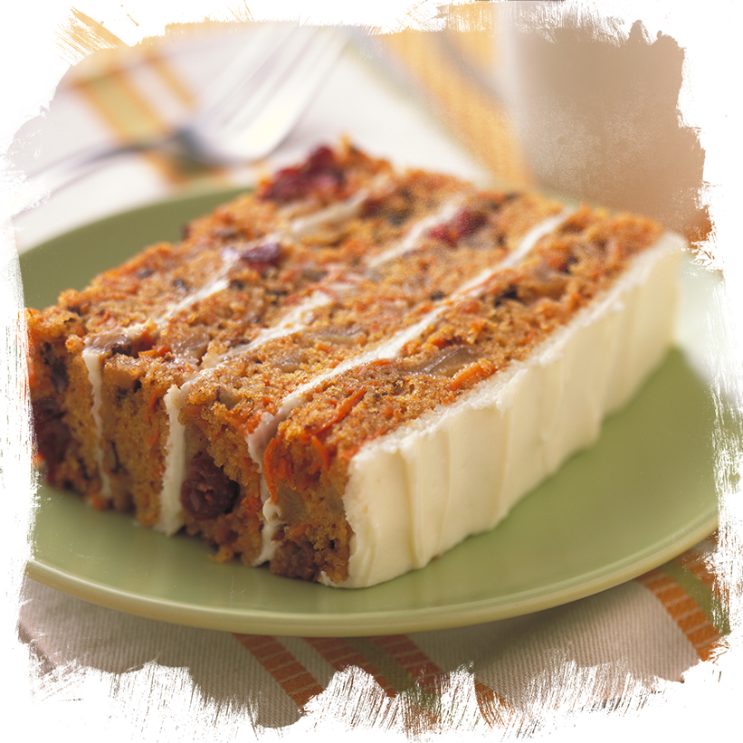 a slice of pear carrot cake on a green plate