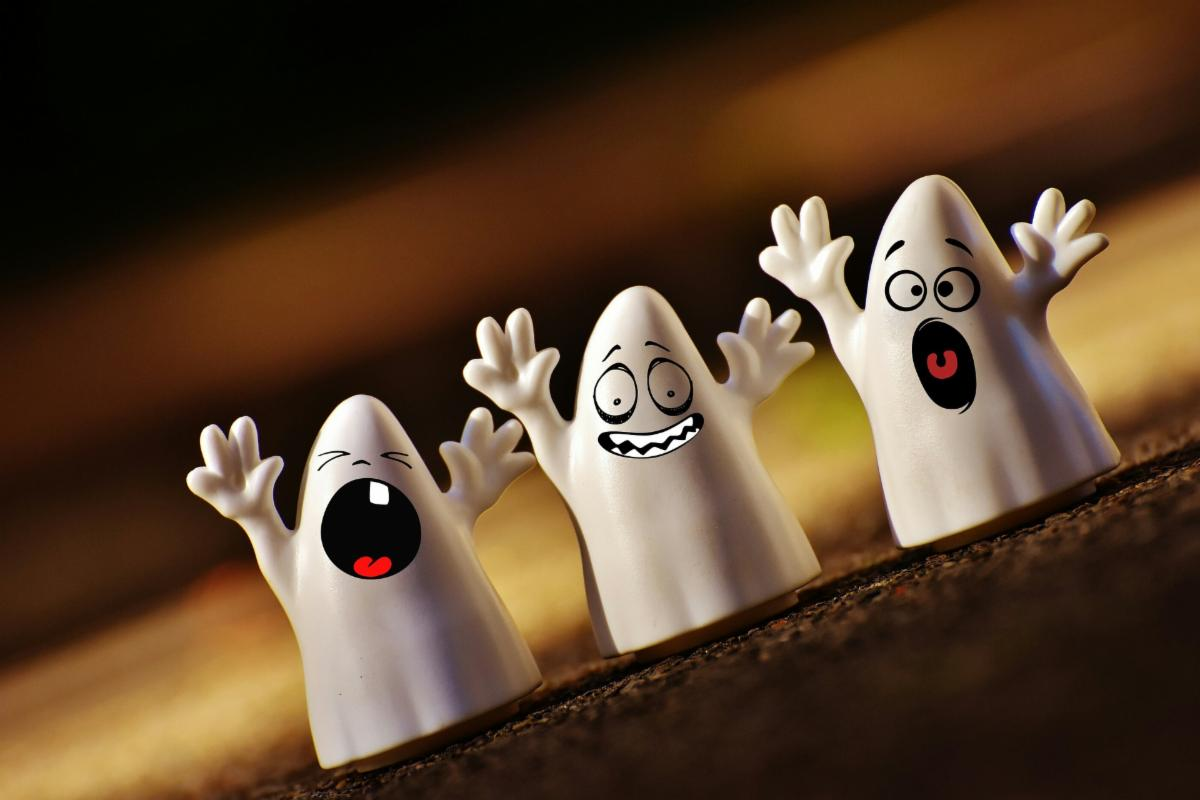 Three cute ghosts looking rather stressed out