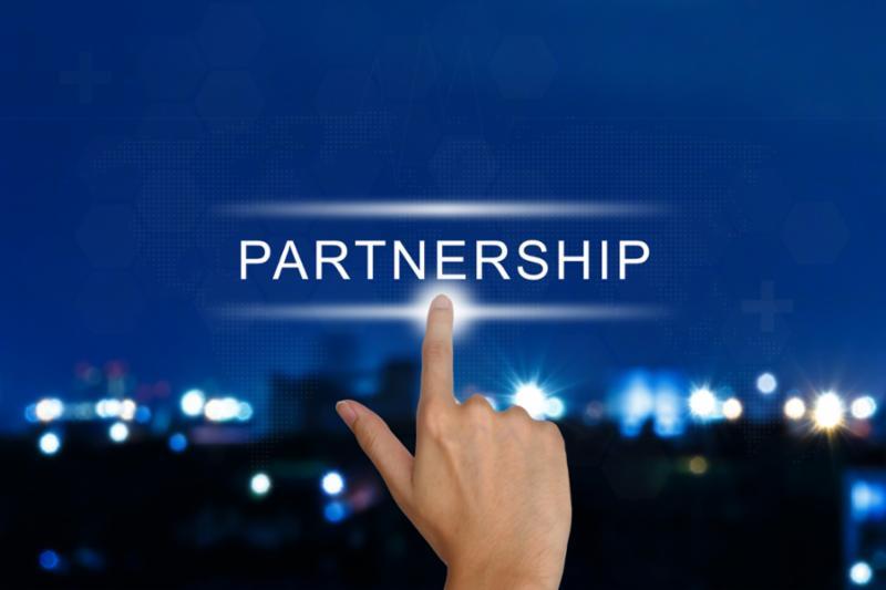 partnership_button_hand.jpg
