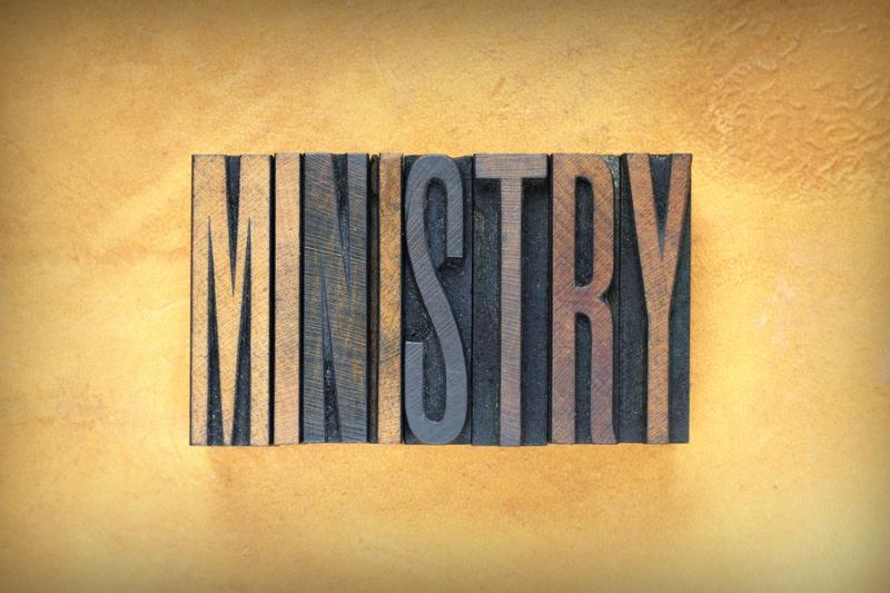 The word MINISTRY written in vintage letterpress type