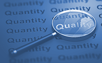 Magnifying glass showing the word Quality