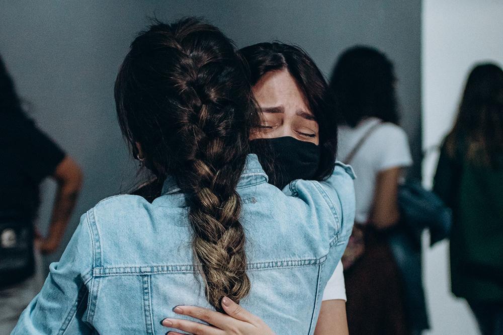 COVID-19 masked hug