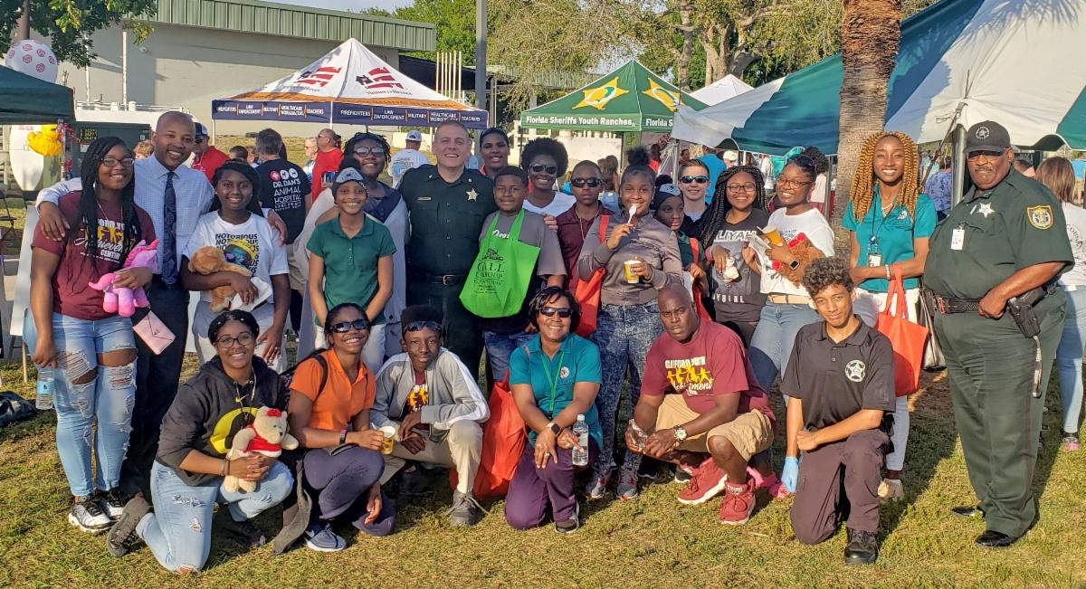 Students pose with Sheriff staff at the 2020 IRC Sheriff's BBQ