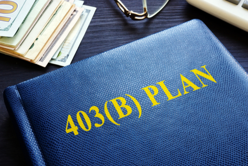 403b Plan and money on a table. Retirement.