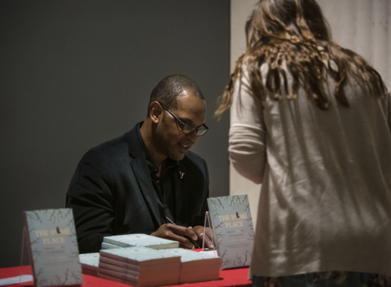 Drew Lanham signs a book for attendee Taylor Robertson.