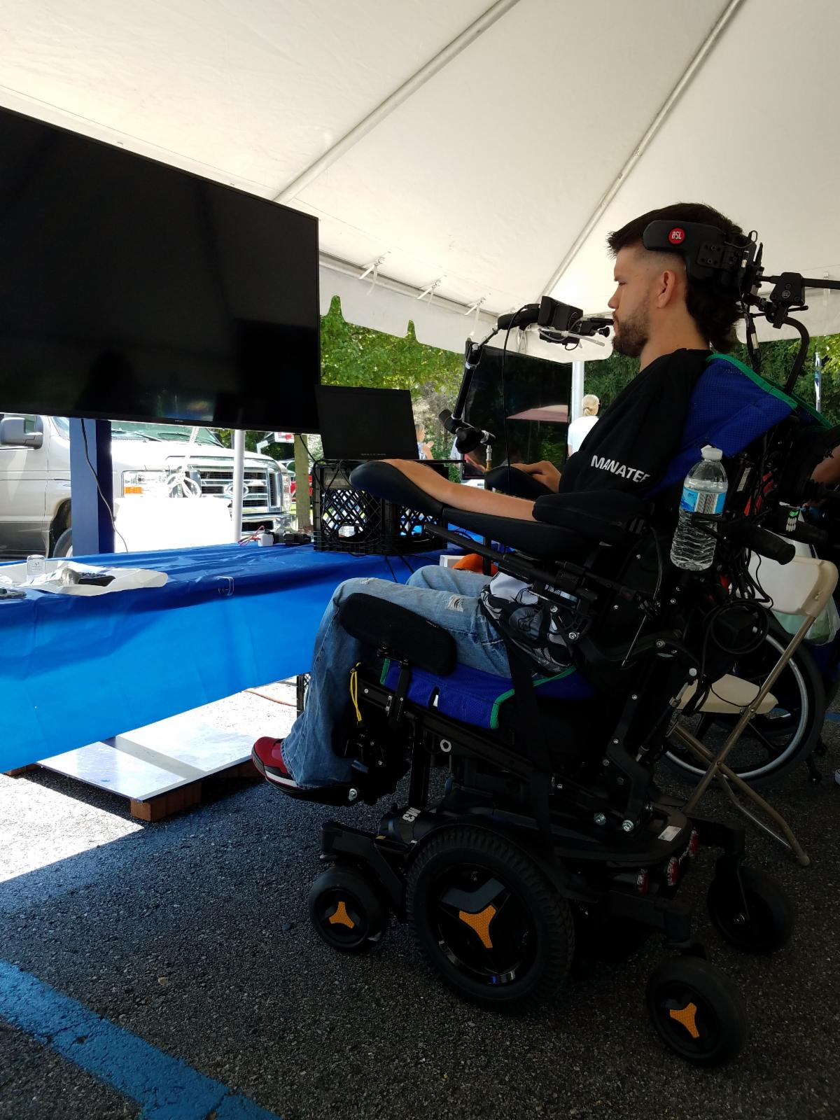 Man with a high level cervical injury uses a sip and puff tool to play video games