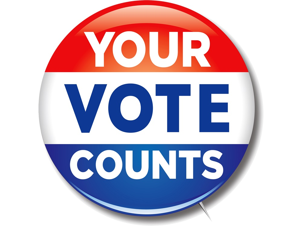 YOUR VOTE COUNTS is spelled out on a button meant for jackets and clothing to support voting.  it i divided into 3 even colors red up top white in middle and blue on the bottom