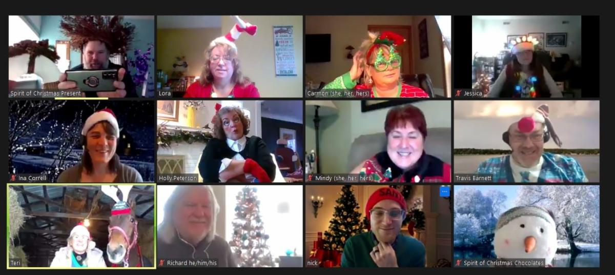screencapture of a zoom meeting with 12 people dressed in festive holiday outfits