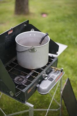 camping-stove with a pot on burners