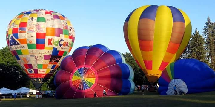 four hot air balloons prepare for takeoff