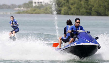 Jetski with waterskiier