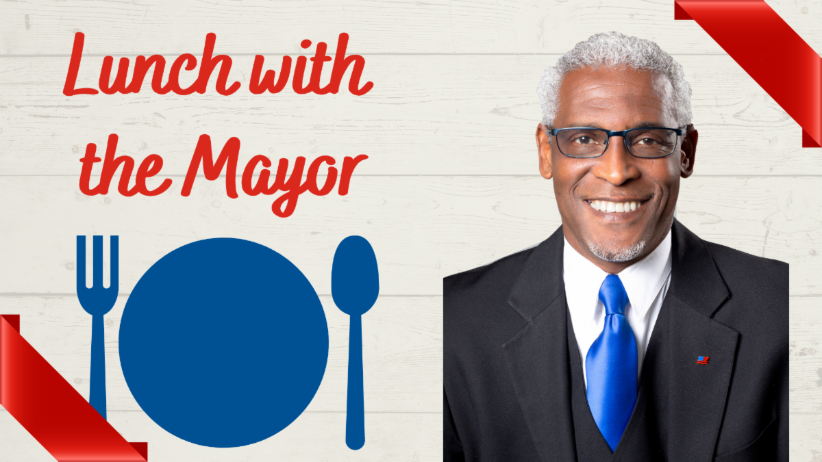 """graphic with text """"lunch with the mayor"""" and clip art plate and utensils and headshot of mayor on wood background"""