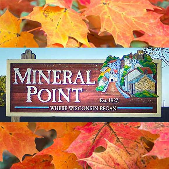 Mineral Point WI sign on fall leaves background.