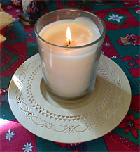 Photo by Kathleen Ernst of a Norwegian style chip carved wooden candle plate.