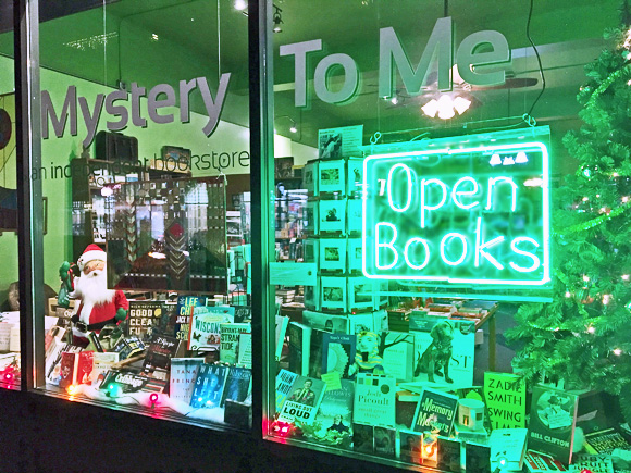 Open Books sign at Mystery To Me bookstore in Madison_ Wisconsin. Photo by Joanne Berg.