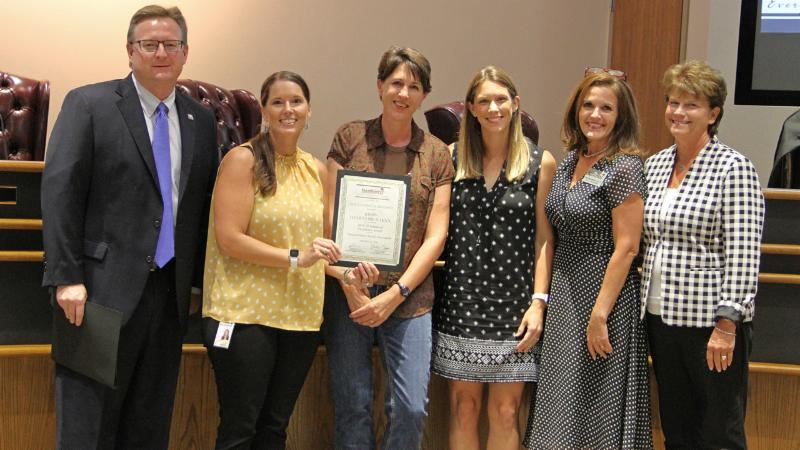 Trustees recognized Justin_s PTA for winning a National PTA award.