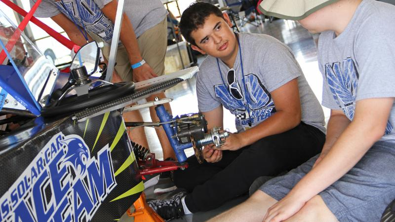 Byron Nelson students work on their vehicle at the Solar Car Challenge