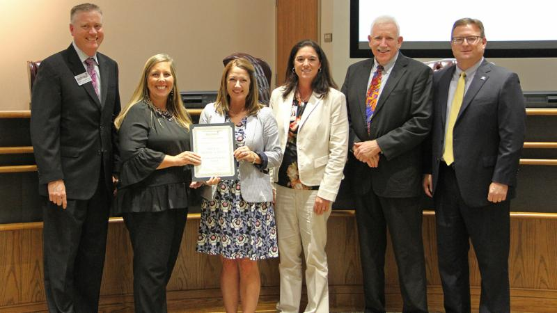 Trustees recognized Medlin Middle School for earning a Promising Practice award.