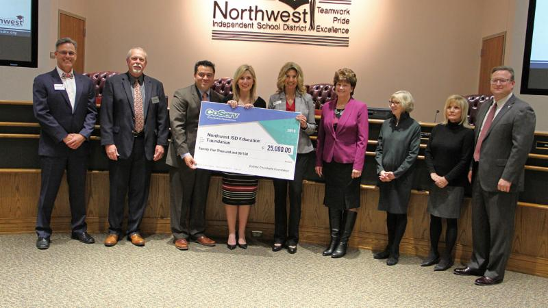 Trustees and NEF accepted a check for student scholarships and teacher grants.