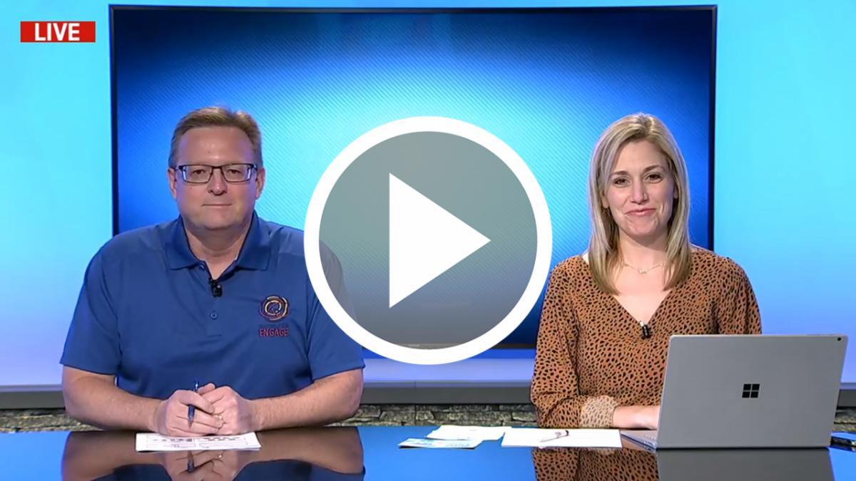 Dr. Ryder Warren and Emily Conklin sitting at the NHSTV news desk