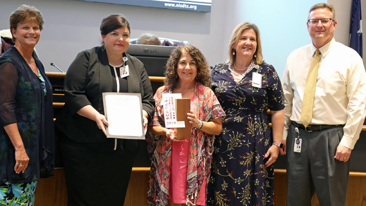 Trustees recognized Hughes for being named a School Transforming Learning.