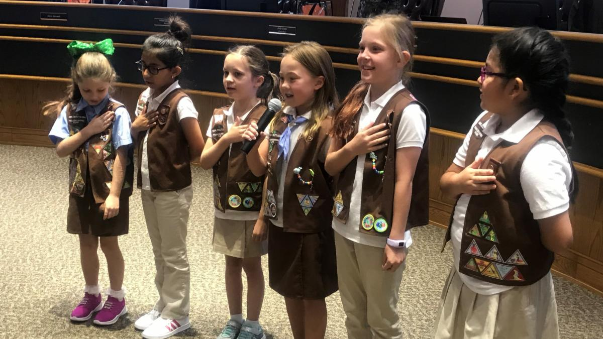 Members of a local Girl Scout troop led the pledge