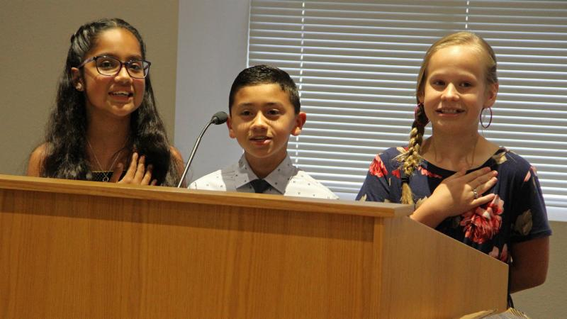 Peterson Elementary School students led the pledges.