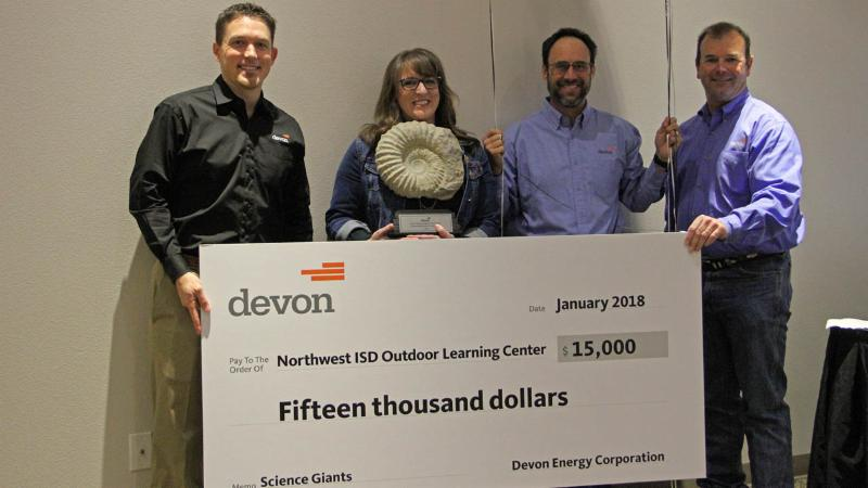 Devon Energy presents the OLC with a check for _15_000