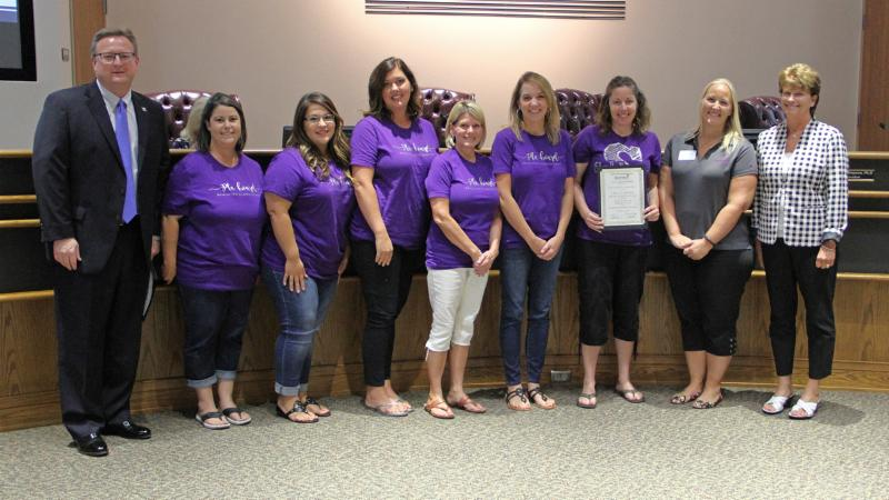 Trustees recognized Schluter_s PTA for winning a National PTA award.
