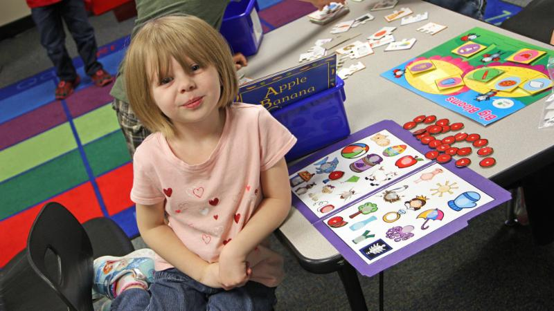 A Pre-K student plays a game