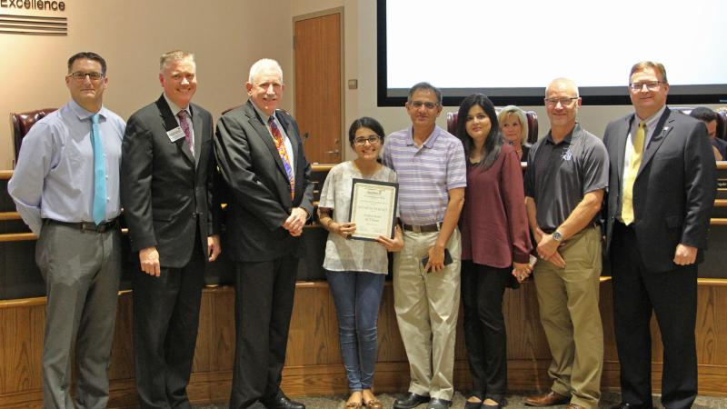 Trustees recognized Byron Nelson_s Haniyah Burney for earning a perfect ACT score.
