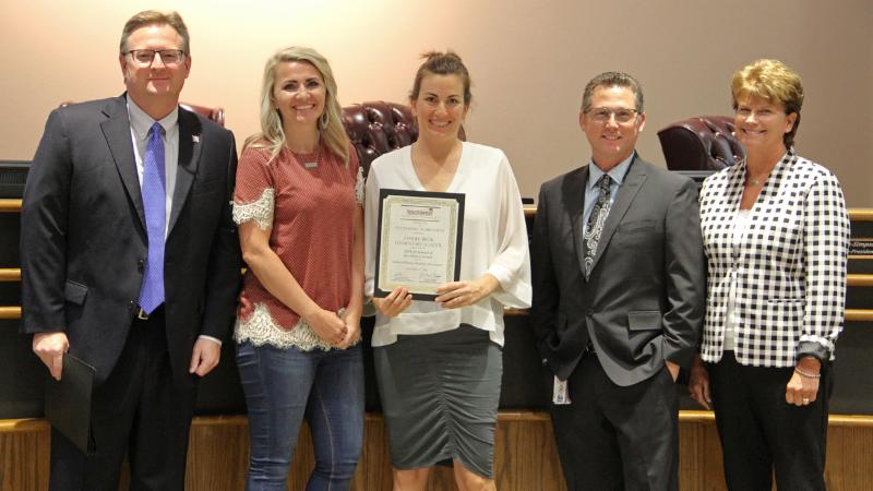 Trustees recognized Beck_s PTA for winning a National PTA award.