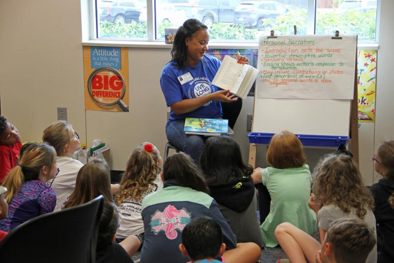 A volunteer reads to children