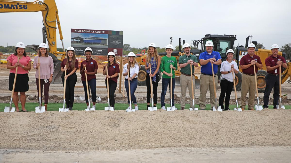 Students and program leads break ground on the aquatics center