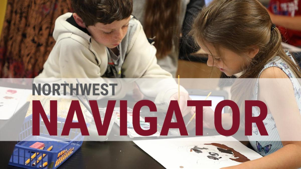 Two students paint dog portraits with the text Northwest Navigator above