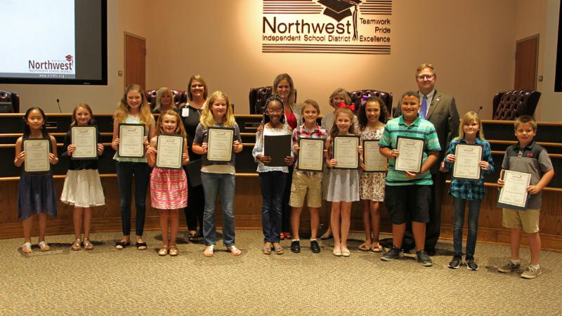 Trustees recognized students from all elementary schools named elementary Writers of the Month.