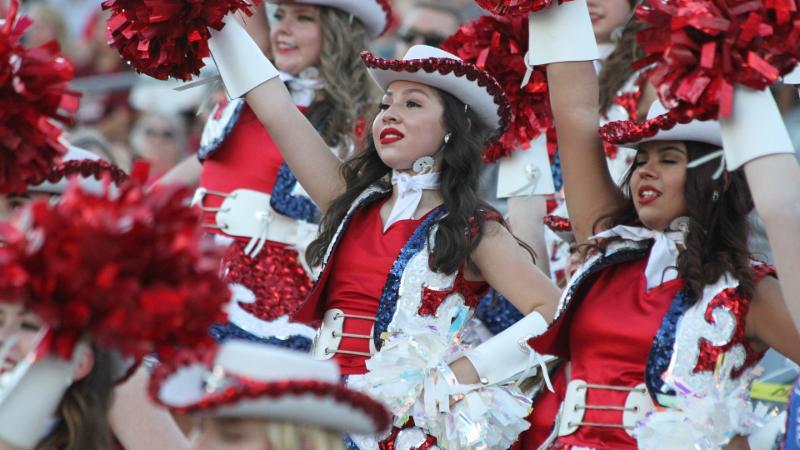 The Northwest Sidekicks perform at a football game
