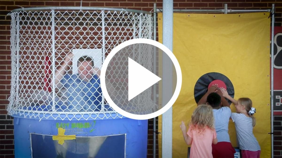 Dr. Warren gets dunked by Hatfield students