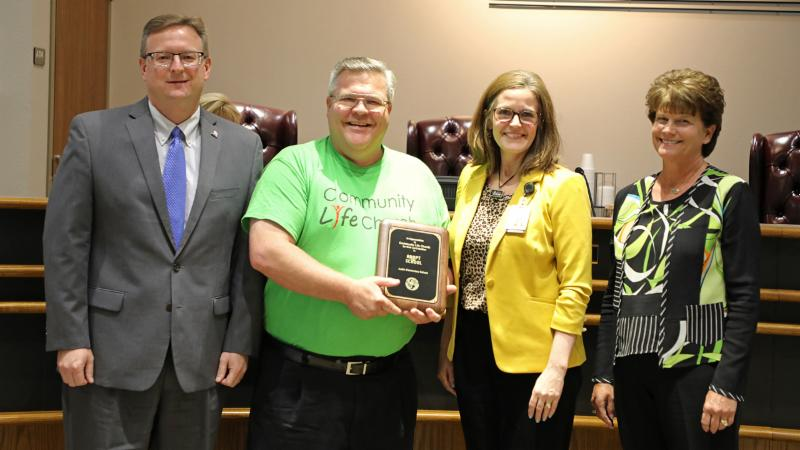 Trustees recognized Community Life Church for its support of Justin Elementary School.