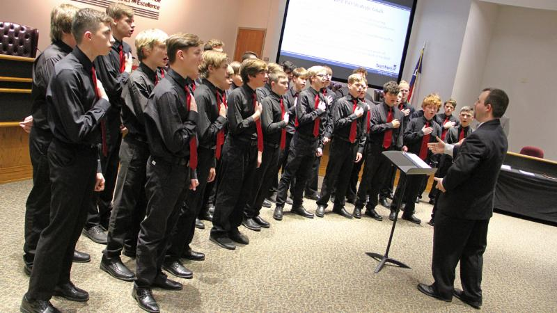 Students from Pike Middle School's boys choir sang for trustees.