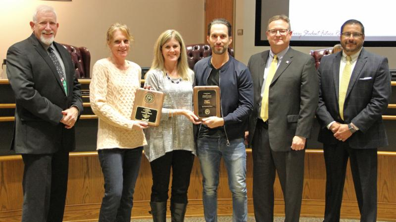 Trustees recognized Compass Church for serving as a district Partner in Education and adopting Cox.