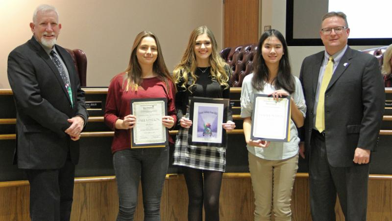 Trustees recognized the winners of the district_s holiday artwork contest.