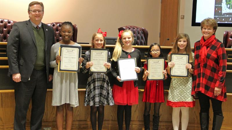 Trustees recognized the winners of the district holiday card contest.